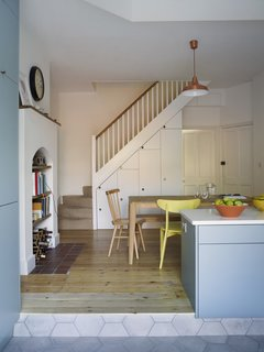 Two Doctors on Honeymoon Come Home to a Kitchen That's Double in Size - Photo 4 of 9 - In the dining area, built-in storage was added beneath the staircase. The table is by Ebbe Gehl for John Lewis and the pendant is by Anglepoise.