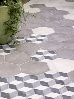 The floor tiles, which create a seamless transition from kitchen to patio, are from the Illustrate line by Solus.