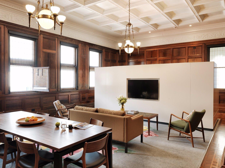 Living Room, Table, Chair, Rug Floor, Coffee Tables, Sofa, Pendant Lighting, and Medium Hardwood Floor  The Old Clare Hotel