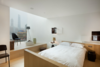 Modern home with Bedroom, Light Hardwood Floor, Recessed Lighting, Chair, Night Stands, Floor Lighting, Bed, and Wall Lighting. Photo  of The Waterhouse at South Bund
