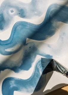 Rebecca Atwood's pillows, duvets, wallpapers, and other designs are made in many places, from Rhode Island to India, but almost all of them start as ideas in her sketchbook. The Tidal Wave fabric series is based on painted squiggles she did in 2016.