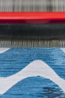 """<b>9Insert the Weft</b> After each pass of the weft pick (a single yarn crossing the warp), the yarns are """"beaten"""" or combed into place to ensure even tension. The weft pick moves so swiftly across the warp that it's sometimes difficult to track with the human eye."""
