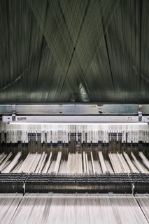 """<b>6 Prepare the Loom</b> The Tidal Wave pattern is woven using a Jacquard loom, a machine that dates to 1804. Today, MTL uses a computer file that acts as the loom's """"brain"""" and controls the binary weaving process."""