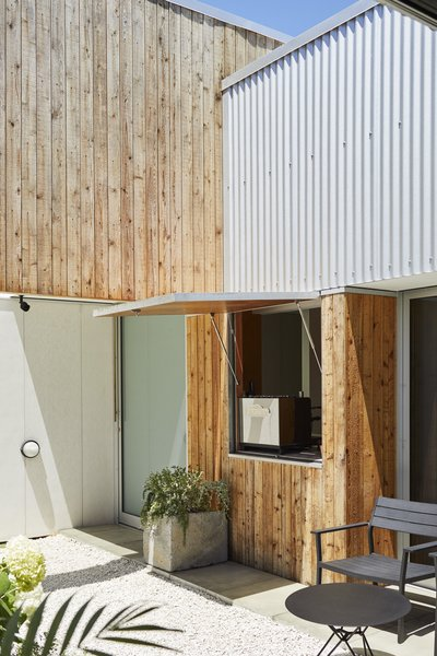 Architect Christopher Beer helped his DIY-friendly former roommates Karen and Grant Jack create a mixed-use dwelling in a town located about 90 miles south of Auckland.