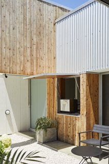 This DIY Home in New Zealand Doubles as a Coffee Spot and Art Gallery - Photo 1 of 16 - Architect Christopher Beer helped his DIY-friendly former roommates Karen and Grant Jack create a mixed-use dwelling in a town located about 90 miles south of Auckland.