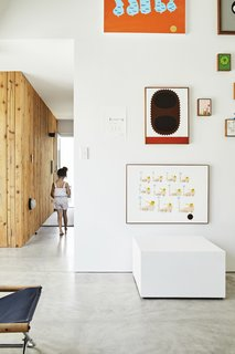 This DIY Home in New Zealand Doubles as a Coffee Spot and Art Gallery - Photo 5 of 16 - Low-cost materials like plaster board, knotty cedar, and polished concrete appear in the gallery as well as in the residence.