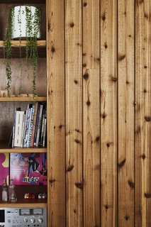 "This DIY Home in New Zealand Doubles as a Coffee Spot and Art Gallery - Photo 13 of 16 - <b>Cabinetry: </b>The owners' biggest savings came from building the cabinetry themselves. Because the house has no garage, the couple wanted lots of indoor storage, which they mostly hid behind flush, full-height ""second-grade"" cedar doors."