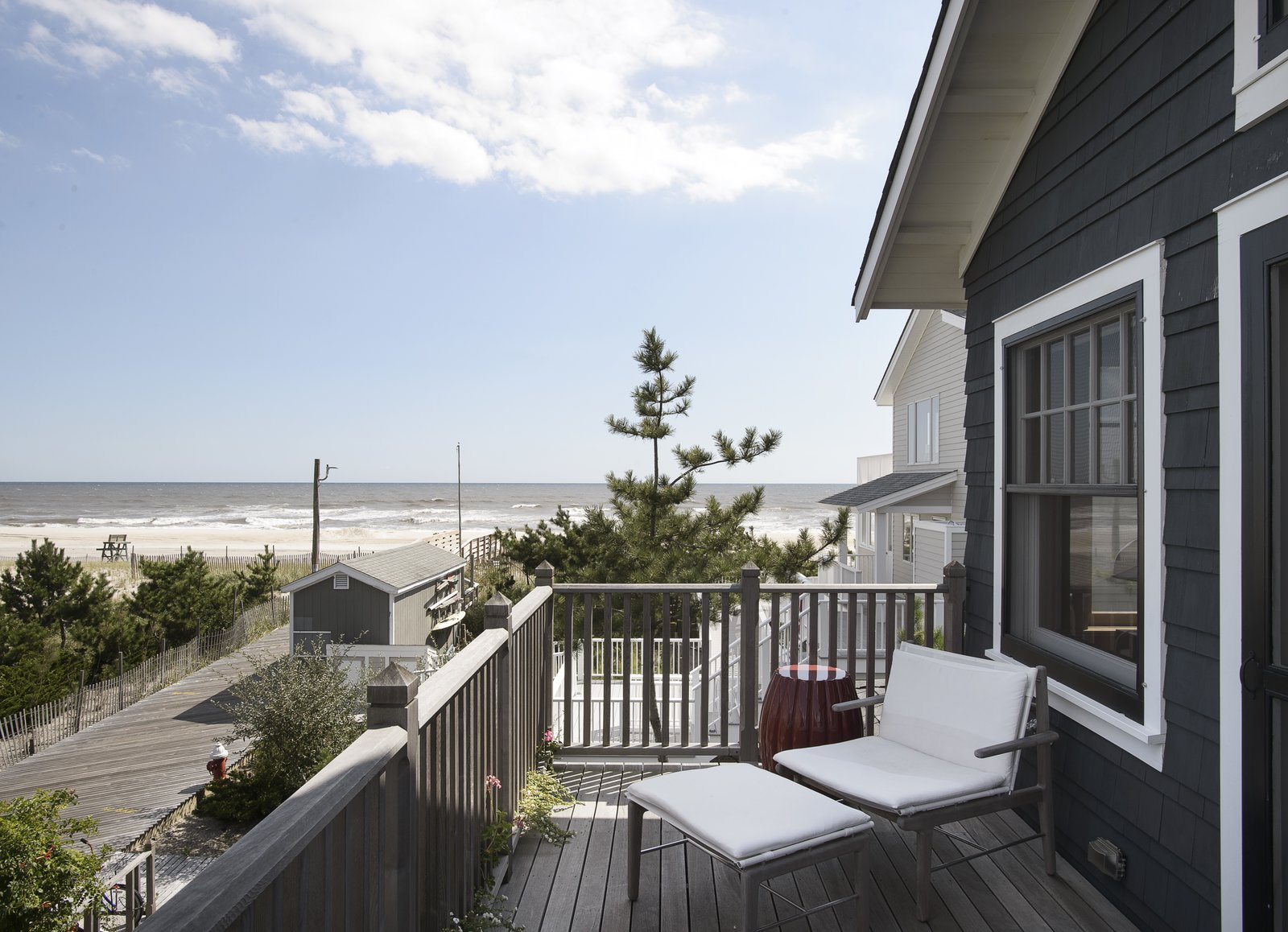 Outdoor, Small Patio, Porch, Deck, Decking Patio, Porch, Deck, Trees, and Side Yard  Best Photos from This Eclectic Beach Bungalow on Fire Island Was Saved After Sandy