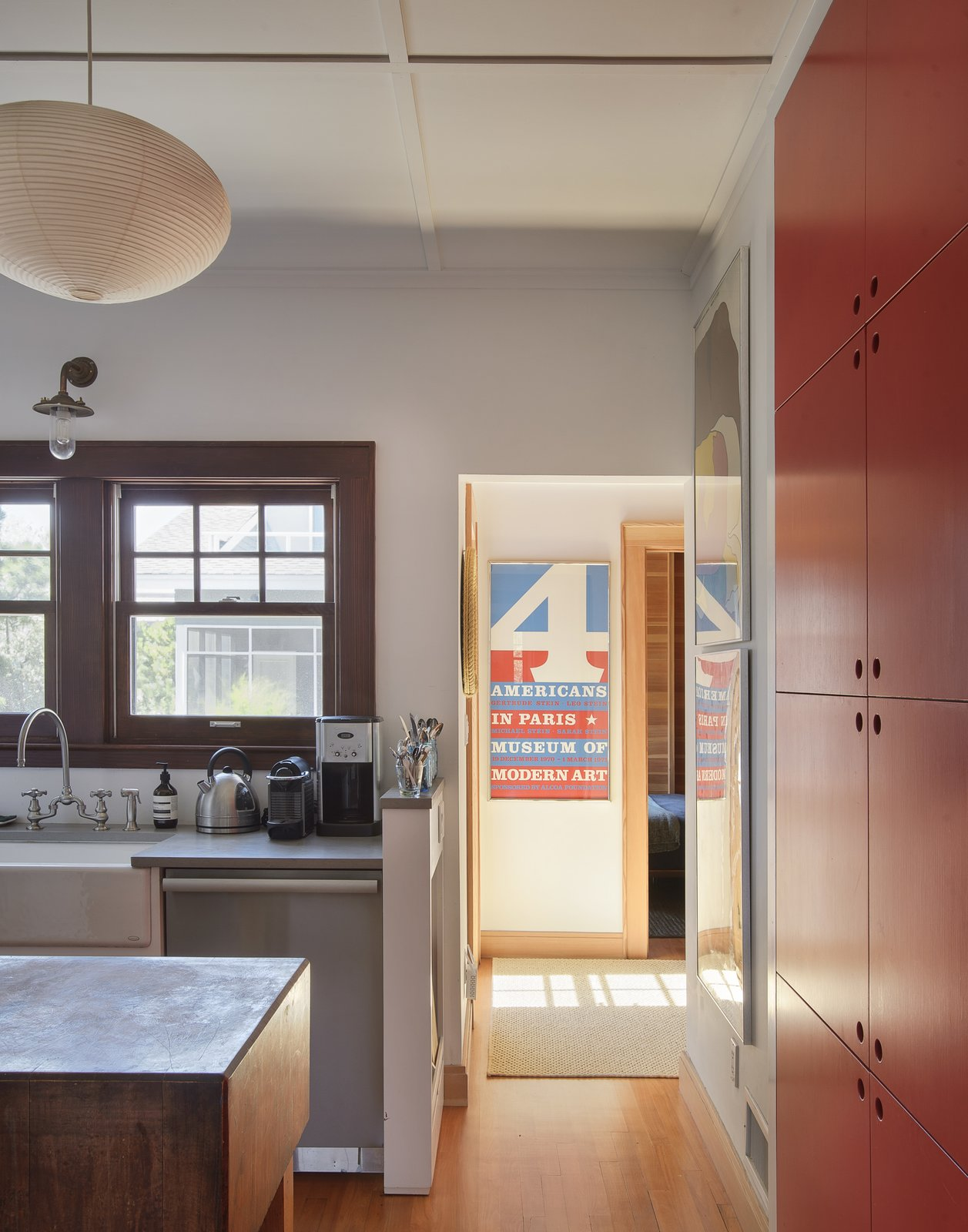 Kitchen, Pendant Lighting, Dishwasher, Vessel Sink, Colorful Cabinet, and Wall Lighting  Best Photos from This Eclectic Beach Bungalow on Fire Island Was Saved After Sandy