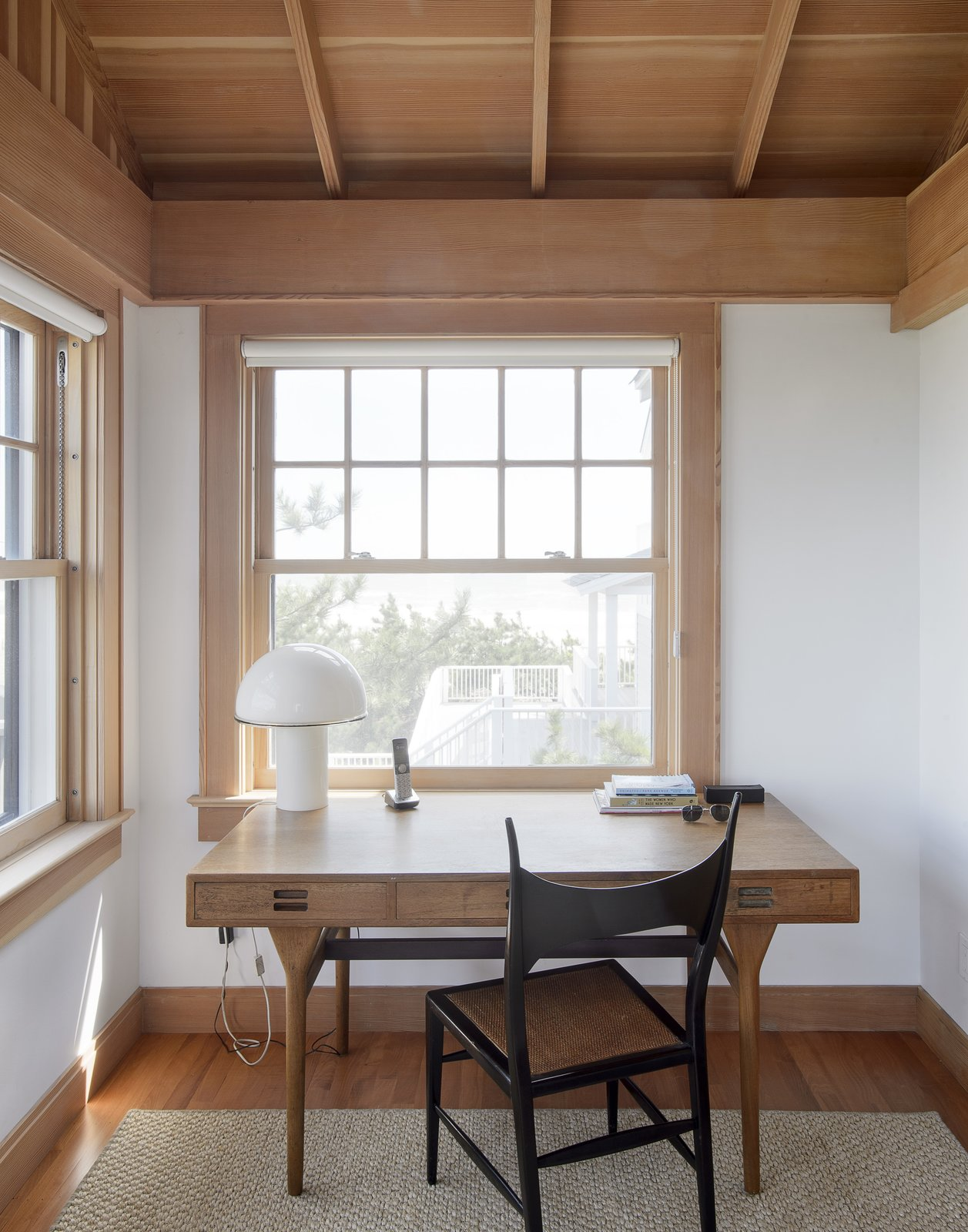 Office, Medium Hardwood Floor, Rug Floor, Lamps, Chair, and Desk  Best Photos from This Eclectic Beach Bungalow on Fire Island Was Saved After Sandy
