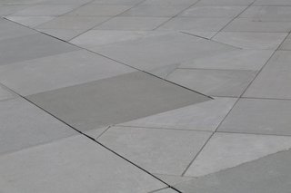 Precast Concrete Roof Pavers are available in 12 standard colors and a variety of finishes. Pedestal set pavers mimic a roof's slope to allow for free flowing drainage.
