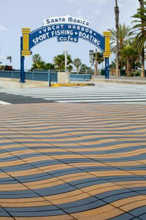 The iconic Santa Monica pier at the corner of Colorado and Ocean Avenues, paved with Stepstone's Wave Pavers.