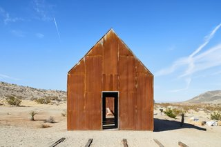 "Naturally rusted steel sheathes the cabins that Malek Alqadi built on a 1954 homestead outside Joshua Tree National Park. ""I loved the idea of stitching the existing structure back together, reinforcing it, and giving it life again without compromising the beautiful setting it's in,"" he says."