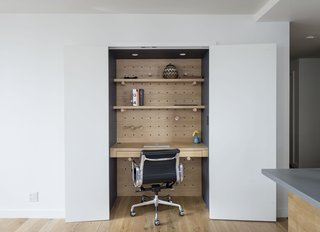 In his office, formerly a closet, the pegs can be rearranged to hang shelving. The Executive Chair is by Charles and Ray Eames for Herman Miller.