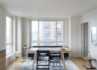The dining chairs and stools are from Crate & Barrel, the Solo sofa is by Antonio Citterio <br>for B&B Italia, and the paper lantern is by Isamu Noguchi.