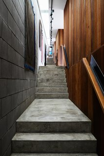 A concrete-block-lined hallway connects the pavilions.
