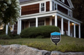 The SimpliSafe security system comes with a stake for the yard, a warning to would-be intruders.