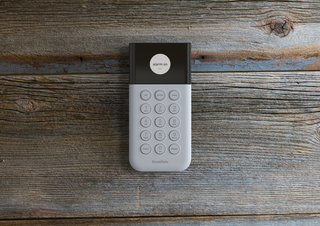 The SimpliSafe keypad, placed by a main entrance, allows homeowners to set their systems upon leaving or entering the house. In another clever design touch, it goes dark when it's not in use so it doesn't distract you, and lights up with a touch when you need to see it.
