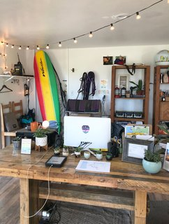 The office is an eclectic mix of plants, camp gear, and rental equipment.
