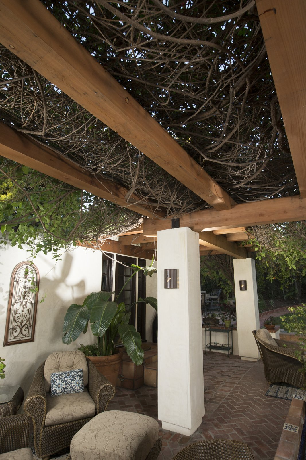 Outdoor, Pavers Patio, Porch, Deck, and Planters Patio, Porch, Deck Decay and termite resistant, and beautiful even when unfinished, redwood proved to be the best choice for this pergola.  Photo 5 of 6 in This Stunning Redwood Pergola Brings Classic Charm to its Hollywood Hills Home