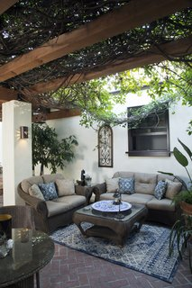 The homeowners determined that redwood timbers would be the best structural support for their tree-like trumpet vines.