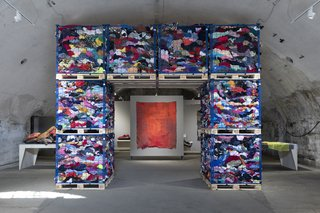 """The """"Arch of Trash,"""" an installation containing three tons of junked clothing, greeted visitors at """"Waste No More."""""""