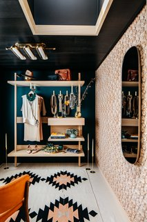 "Aptly named ""A Day In Her Shoes,"" Gretchen Murdock (of Modtage Design)'s vintage-meets-modern styling room is ""inspired by the past, enchanted with the present–a room that blends the vintage treasures of days gone by with the fresh allure of days to come. The open wardrobe transforms her clothing and accessories into an exhibit, beautifully displaying each element of her wardrobe."" In choosing pieces to outfit the room, the interior designer focused on sourcing from sustainable, local, and female-led businesses."