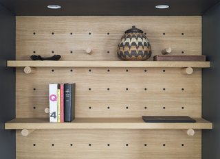 Adjustable pegboards help lawyer Dan Franklin manage his compact apartment in downtown Manhattan.