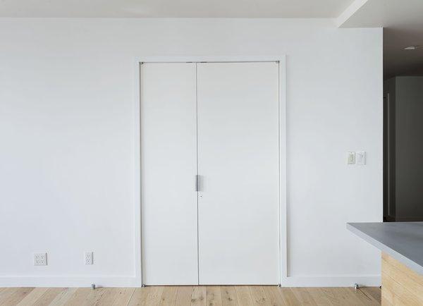 The workspace disappears behind custom doors.