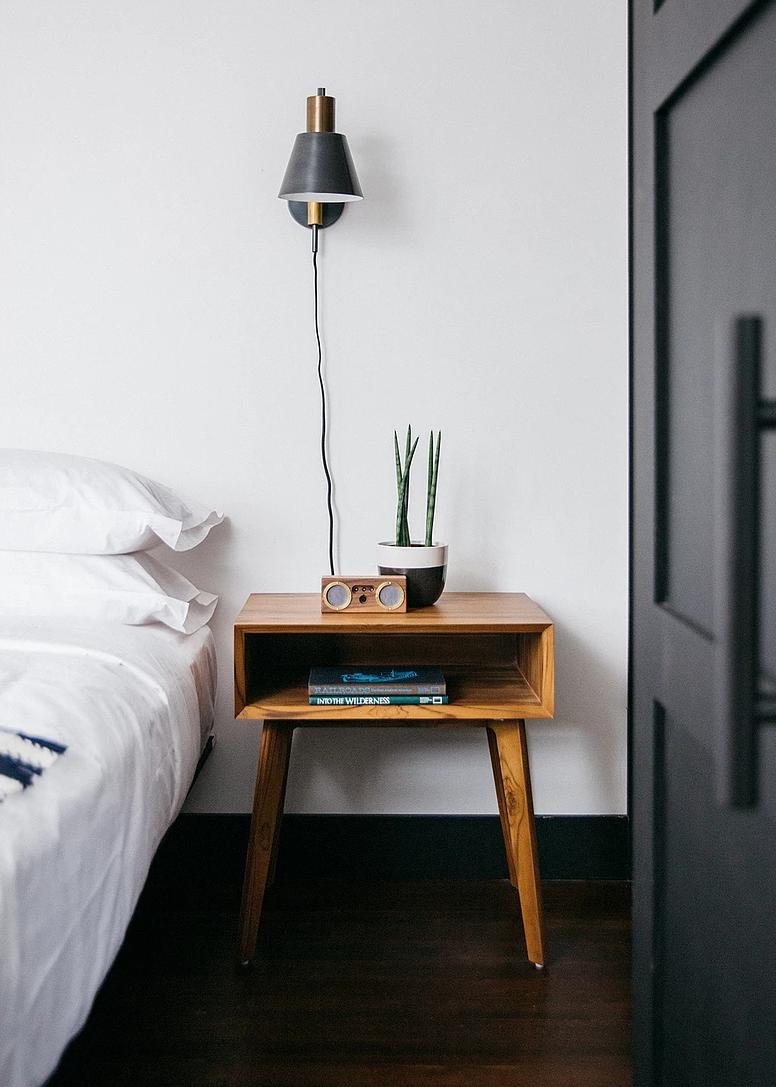 Bedroom, Bed, Night Stands, Dark Hardwood Floor, and Wall Lighting  Eastwind Hotel & Bar