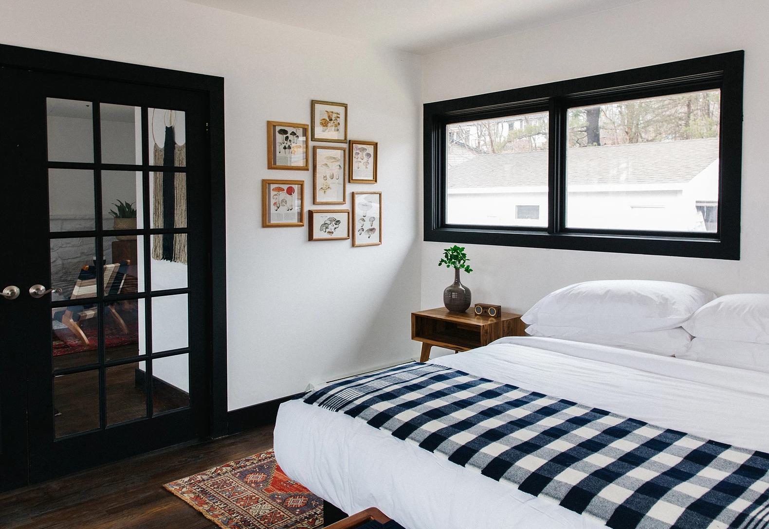 Bedroom, Bed, Dark Hardwood Floor, Rug Floor, and Night Stands  Eastwind Hotel & Bar