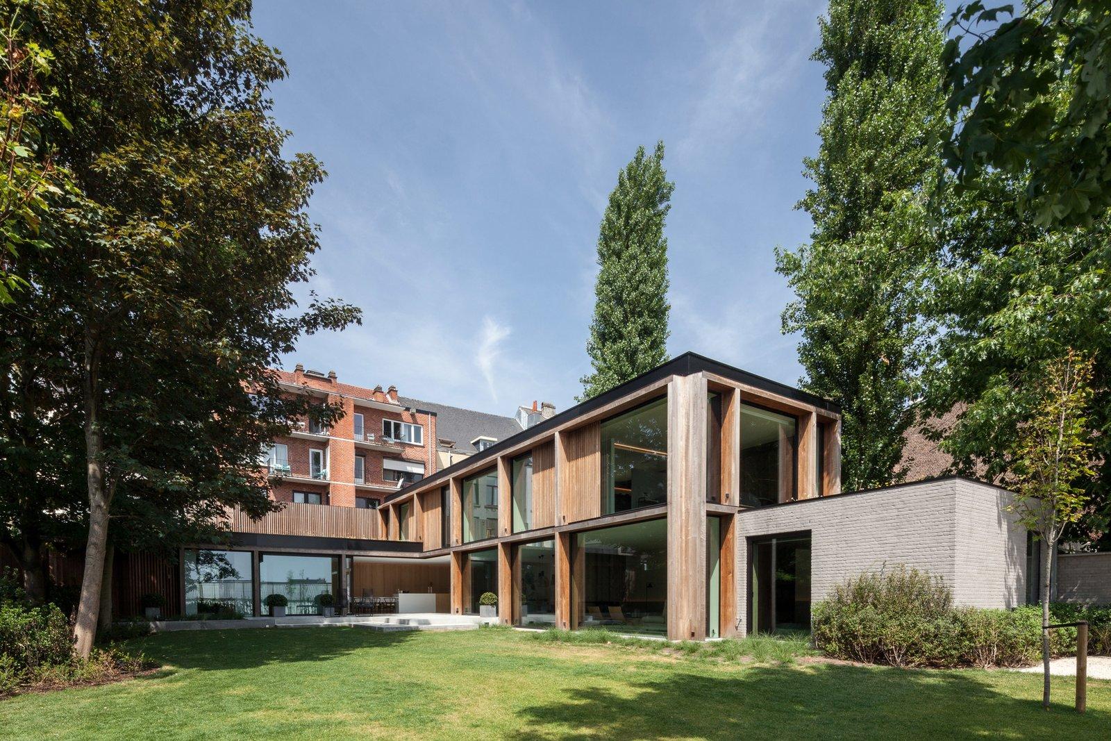 Exterior, House, Wood, Flat, Glass, and Brick  Best Exterior Glass Brick Wood Photos from This Glass Pied-à-Terre Is Hidden in a Belgian Garden