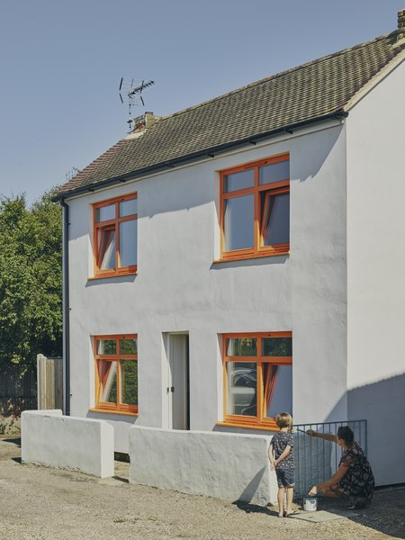 As part of a nine-month renovation, the exterior of Natasha Hart and Oliver Whitmarsh's cottage in Margate, England, was converted from pebble dash to insulated render.