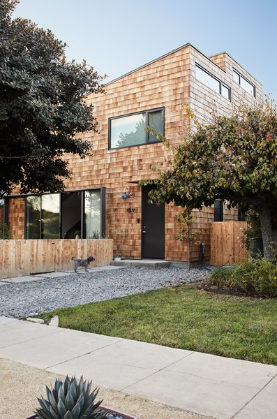 Exterior, House Building Type, and Wood Siding Material The black door and window frames provide a contrast to the cedar siding.  Photo 16 of 17 in Explore the Japanese-Style Home of Two L.A. Tastemakers