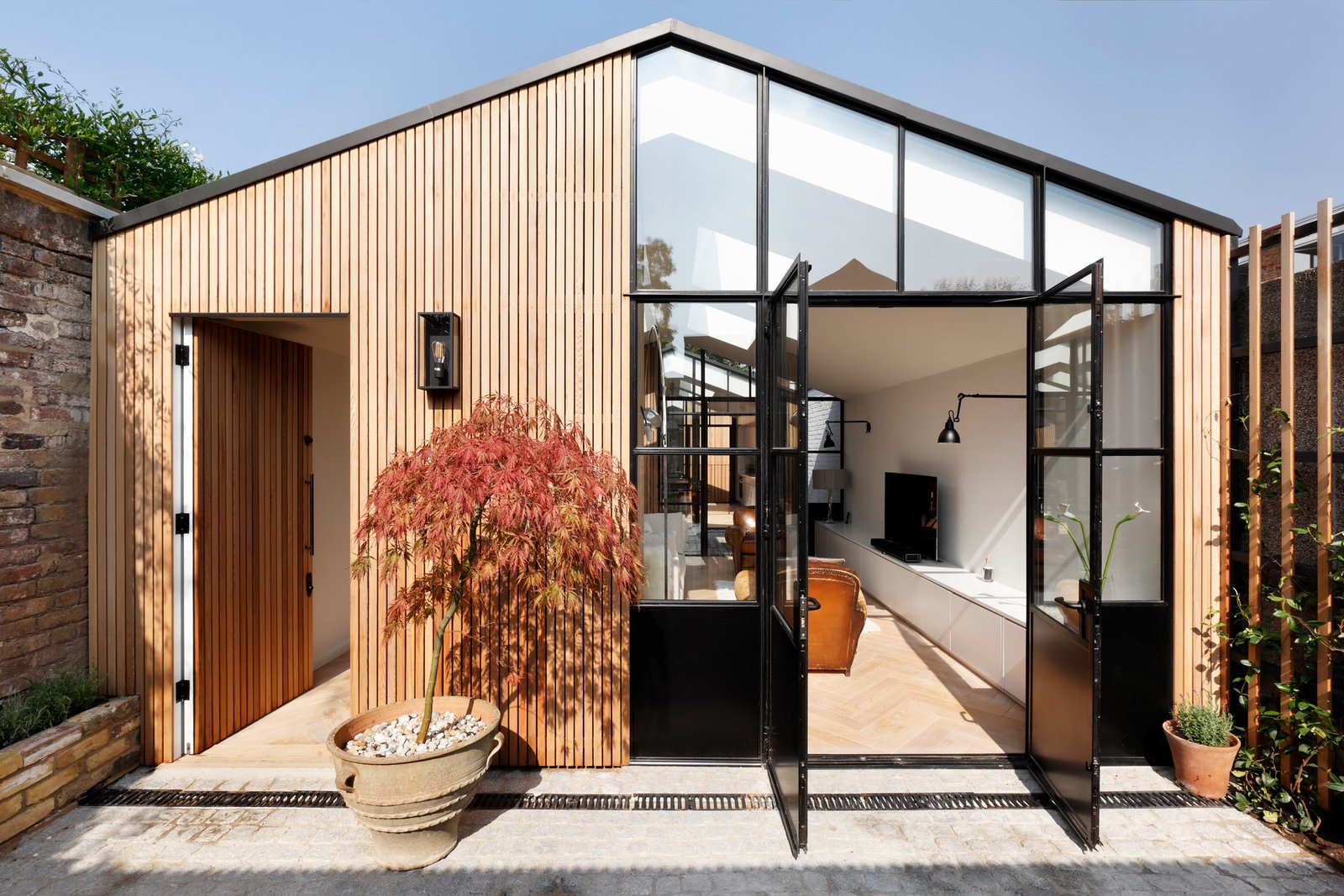 Exterior, House Building Type, Wood Siding Material, Gable RoofLine, and Glass Siding Material  Photos from A London Shed Becomes an Airy Home Lit By Three Courtyards