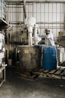 3 Mix the Lime Wash. Once the slaked lime has been aged, Cruz Garcia pours it into steel mixing drums, where it's combined with de-ionized water and natural binders. The batches are relatively small, averaging 200 to 300 gallons.