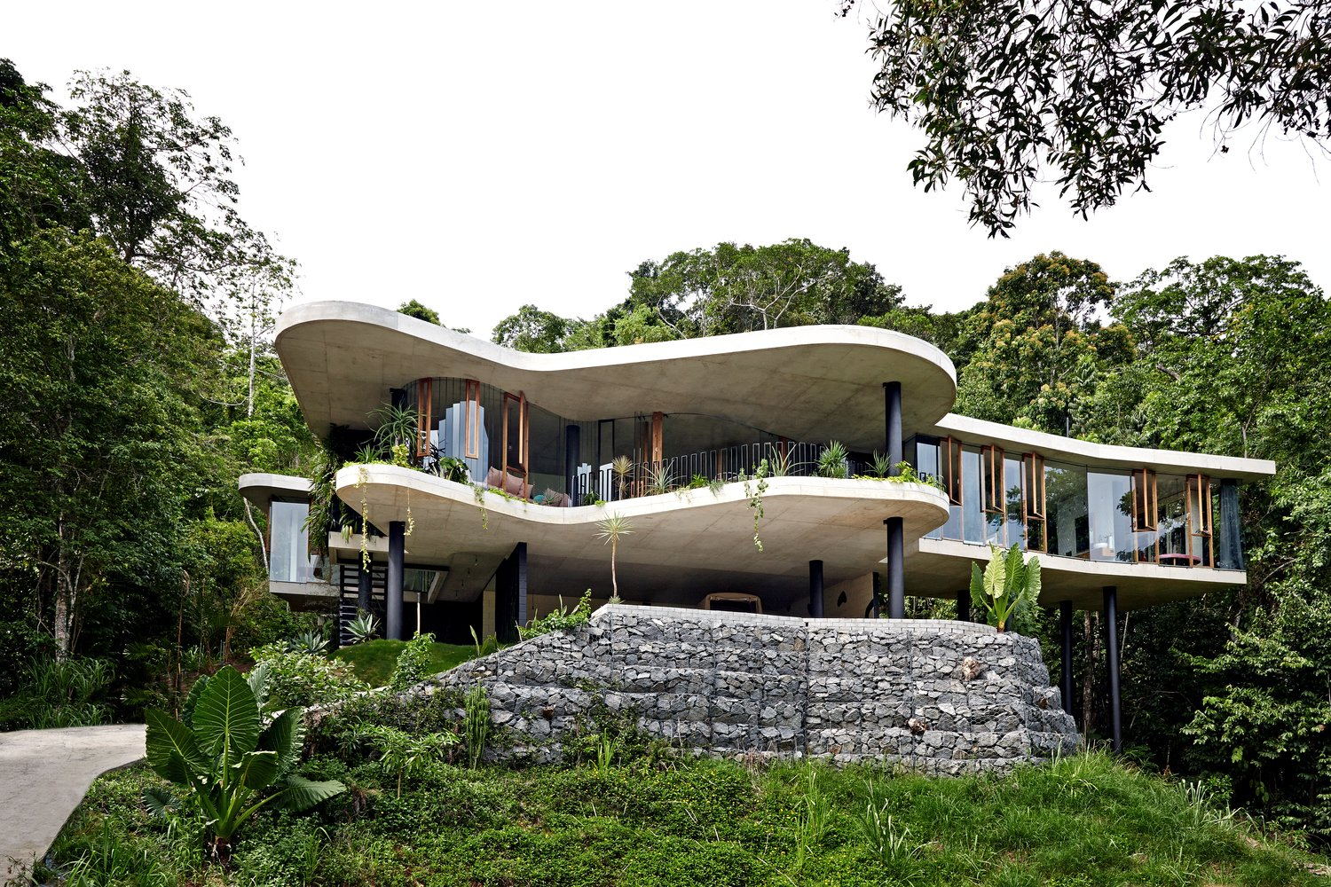 Exterior, Glass, House, Green, Flat, and Concrete  Best Exterior Glass Green Photos from A Funky, Curvaceous Rainforest Home in Australia Hits the Market