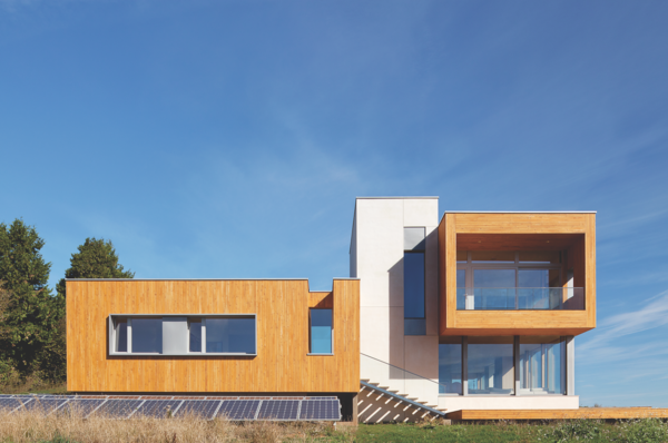 The contemporary, wood and glass home stands out yet nestles right in to the hillside of Newberg, Oregon.