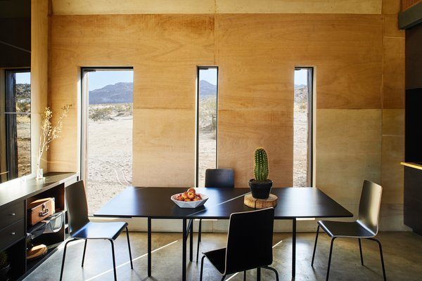 The dining area features a Snaregade Table by Norm Architects for Menu.  Photo 10 of 13 in These Tiny, Off-the-Grid Cabins Near Joshua Tree Look Totally Apocalypse-Proof