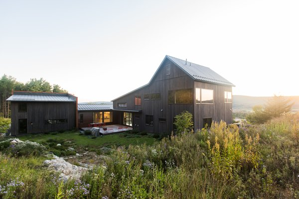 Riffing on local farmhouses, architects Patrick Walker and Elizabeth Demetriades covered the 4,000-square-foot house in rough-sawn red cedar and capped it with a standing-seam galvalume roof.