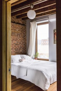 The guest room features a bed from West Elm.