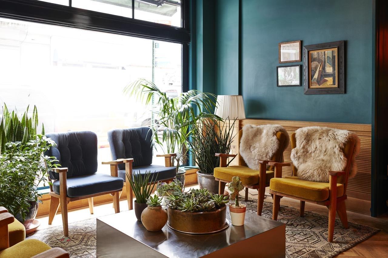 Living Room, Coffee Tables, Chair, Floor Lighting, Medium Hardwood Floor, and Rug Floor  Freehand New York