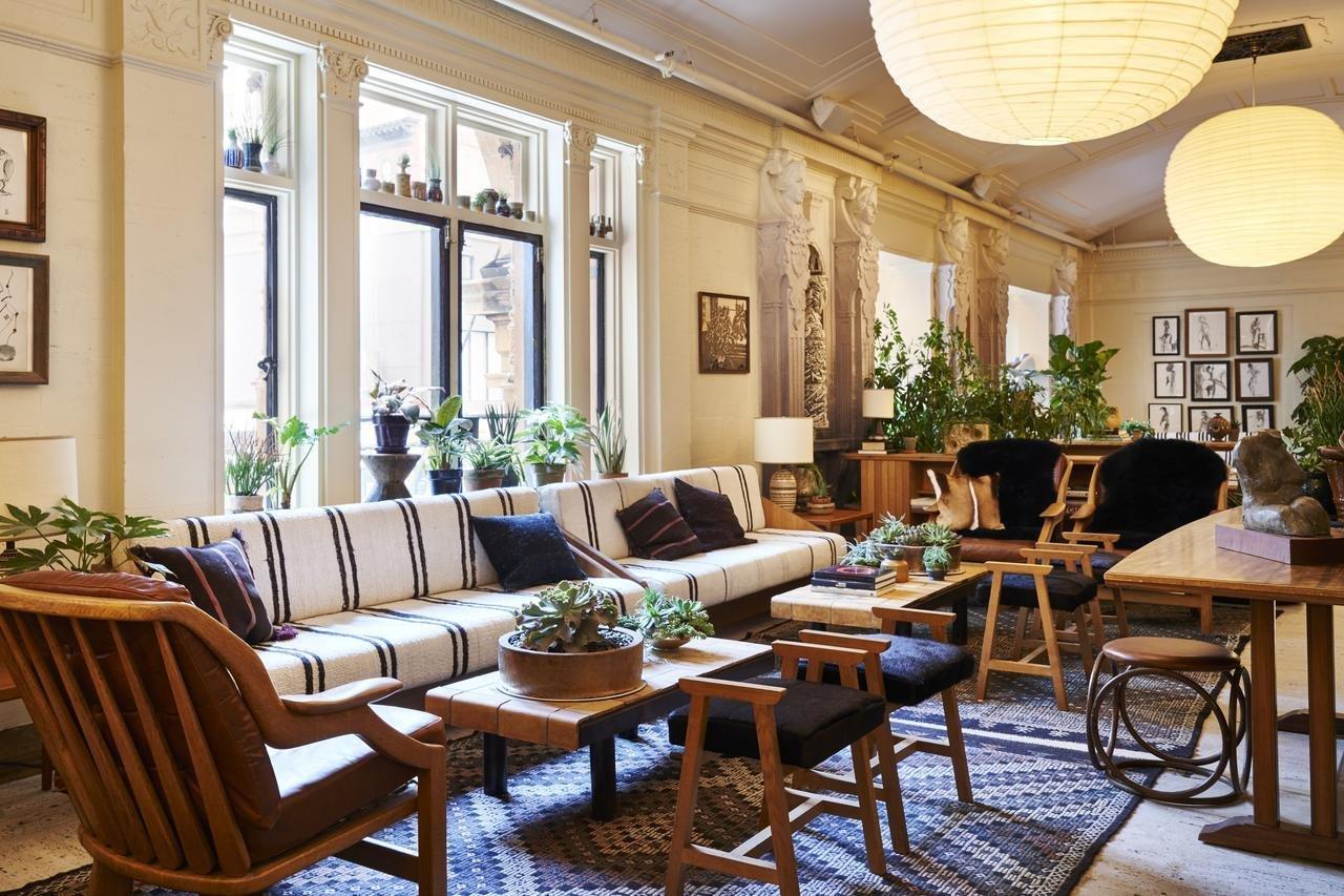 Living Room, Sofa, Coffee Tables, Rug Floor, Pendant Lighting, Medium Hardwood Floor, and Chair  Freehand New York