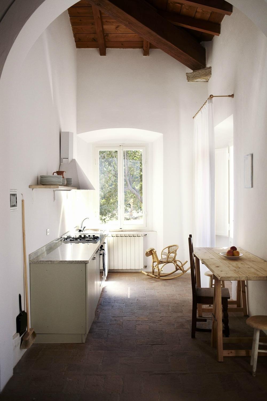 Kitchen, Cooktops, Wall Oven, Range Hood, and Brick Backsplashe  Villa Lena Agriturismo