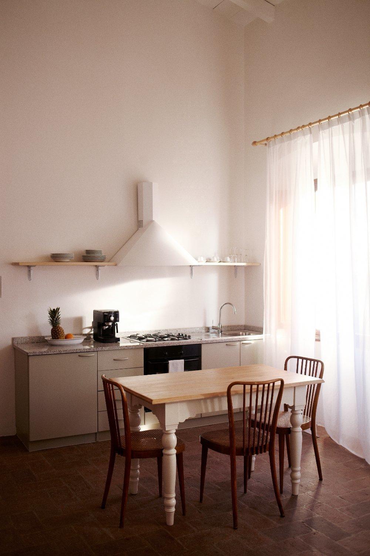 Kitchen, Cooktops, Wall Oven, Range Hood, Drop In Sink, and Brick Floor  Villa Lena Agriturismo