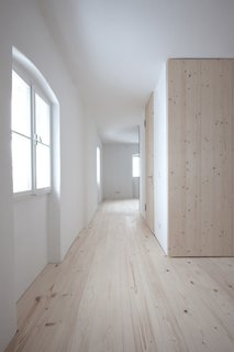 In each unit, the architects placed storage and a bathroom in a self-contained wood cube in the middle of the space.