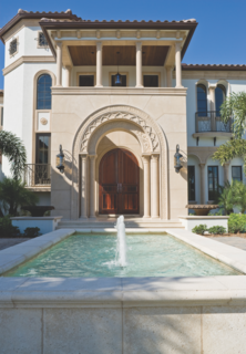 To execute the Mediterranean Luxe look in your home, select a heavy, ornate door, and maybe consider a grand archway over your entry.