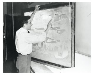 Adler Schnee's husband and business partner, Edward Schnee, with the silkscreen for her pattern Germination (1948), which was influenced by the earth formations they saw on their honeymoon in Arizona.