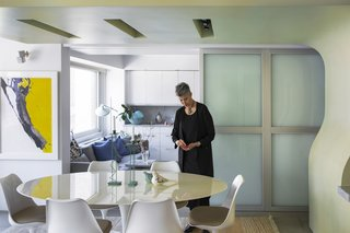 Hariri was determined that no area of the house was closed off, only to be used on special occasions. So her living and dining areas are an open space, separated from the kitchen by metal and glass doors that are rarely shut. On the occasion that they are, the doors still allow light and sound through, creating a sense of togetherness even with physical separation.