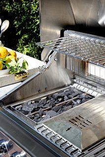 Chef Ludo loaded up the grill's smoker and charcoal tray with briquettes to add the flavors of a traditional barbecue.